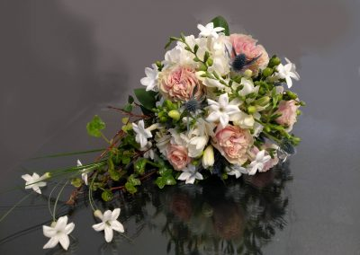 Cascading Bouquet in Whites, Pinks, and Greens.